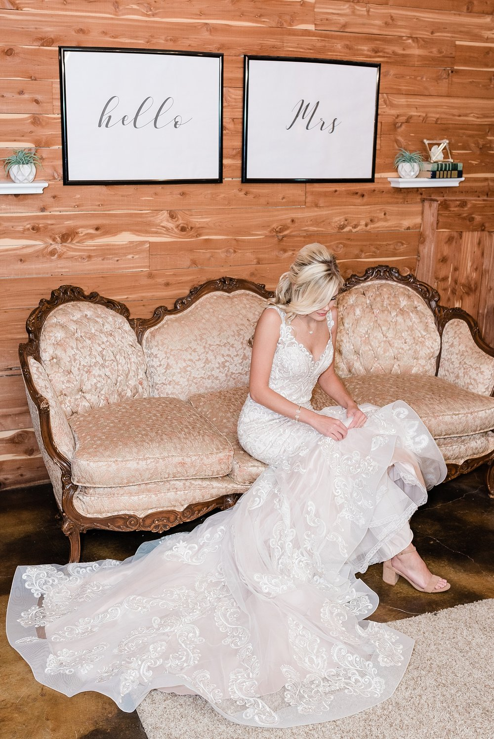 bride having a quiet moment in bridal suite at mighty oak lodge
