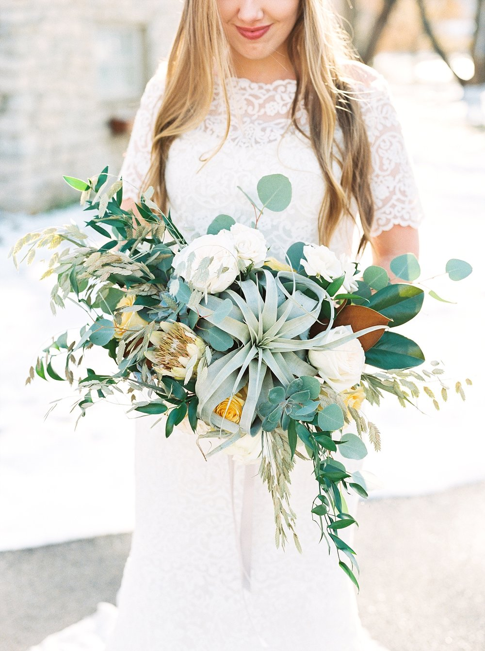 Snowy Winter Wedding at Wildcliff Events Lake With Earthy Jewel Tones and Organic Refined Style by Kelsi Kliethermes Photography Kansas City Missouri Wedding Photographer_0139.jpg