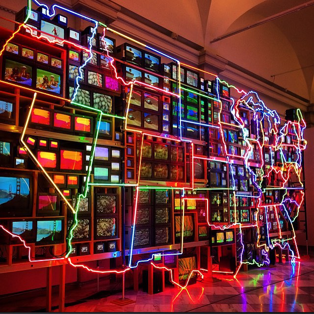 Nam June Palk,  Electronic Superhighway: Continental U.S., Alaska, Hawaii . Fifty-one channel video installation (including one closed-circuit television feed), custom electronics, neon lighting, steel and wood; color, sound). (1995)