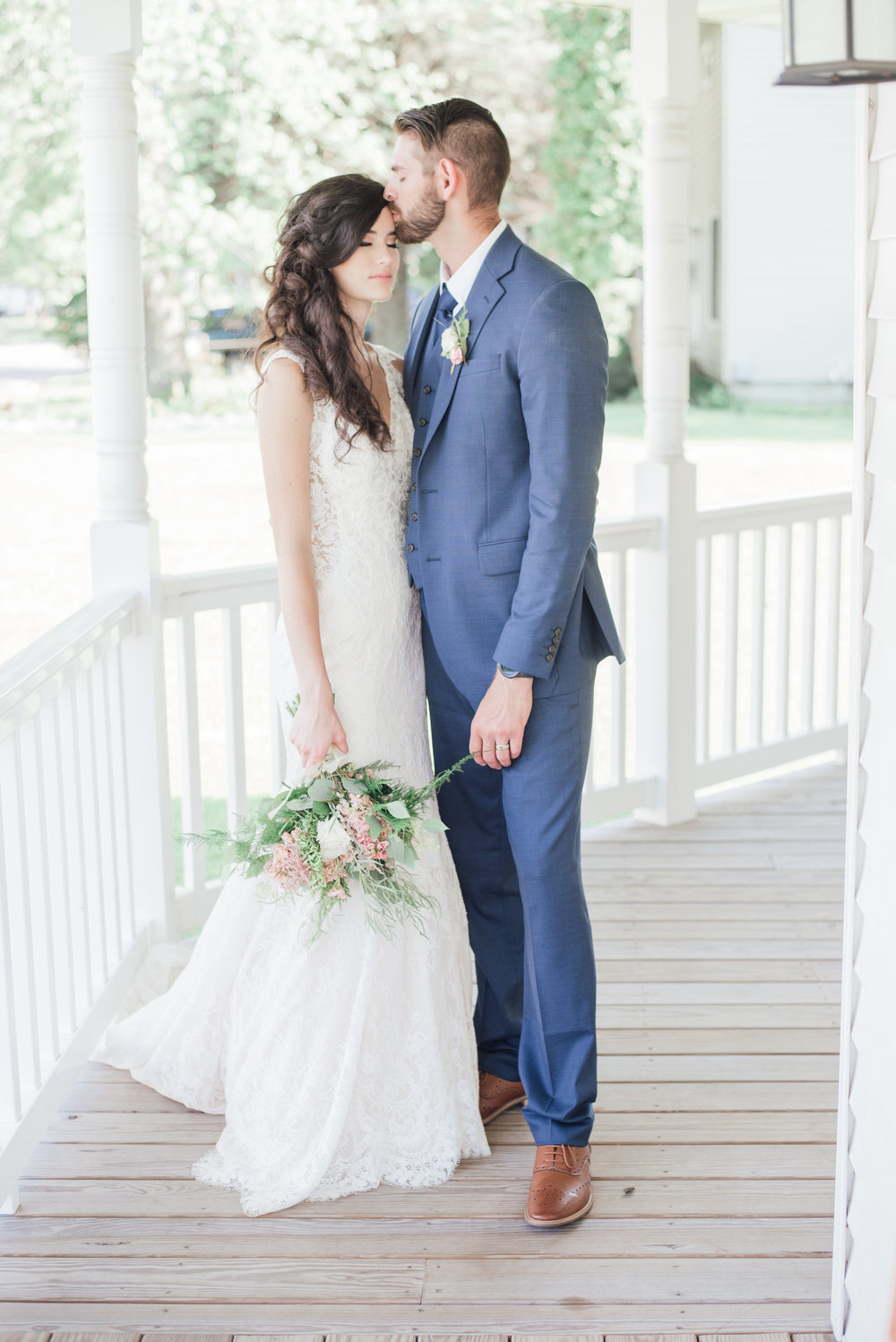 Although it didn't rain on Matt and Stacy's big day, this white porch is an example of a perfect location for a rainy day. We would've been able to get very similar pictures with natural light on a rainy day.