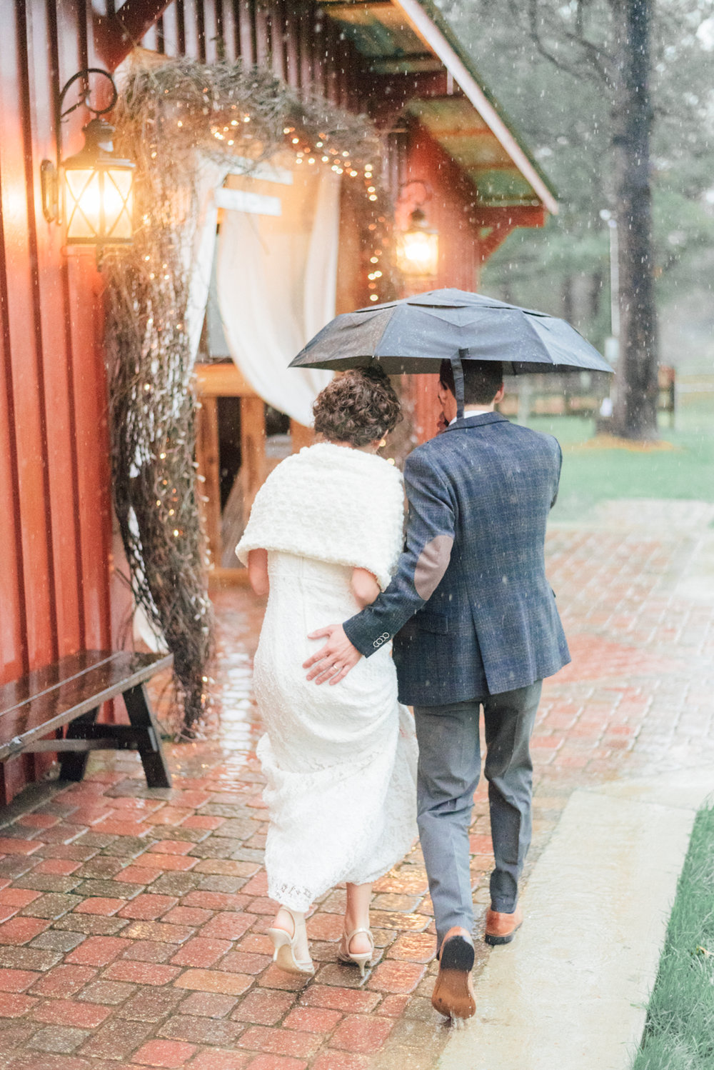 I love this candid shot from Katie and Cody's wedding day! The rain didn't stop us from getting some great pictures.