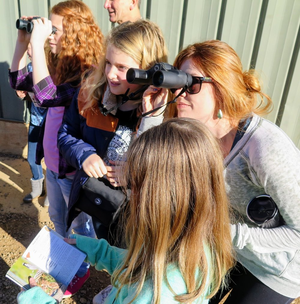 Parents and community volunteers make it possible for our students to enjoy a small group birding experience.