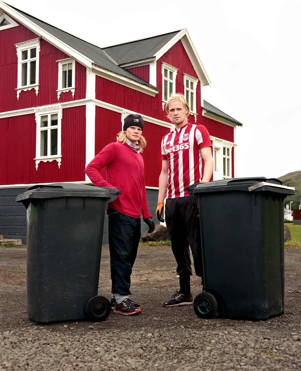 "I was sitting at my desk when I saw Birkir and Kristófer hanging off the back of the garbage truck. I ran after them and had a minute to make their portrait. Their boss kept driving so as soon as we were done they had to run after him to collect the next trash cans. ""We start around 9 and finish the town around 11- 12."""