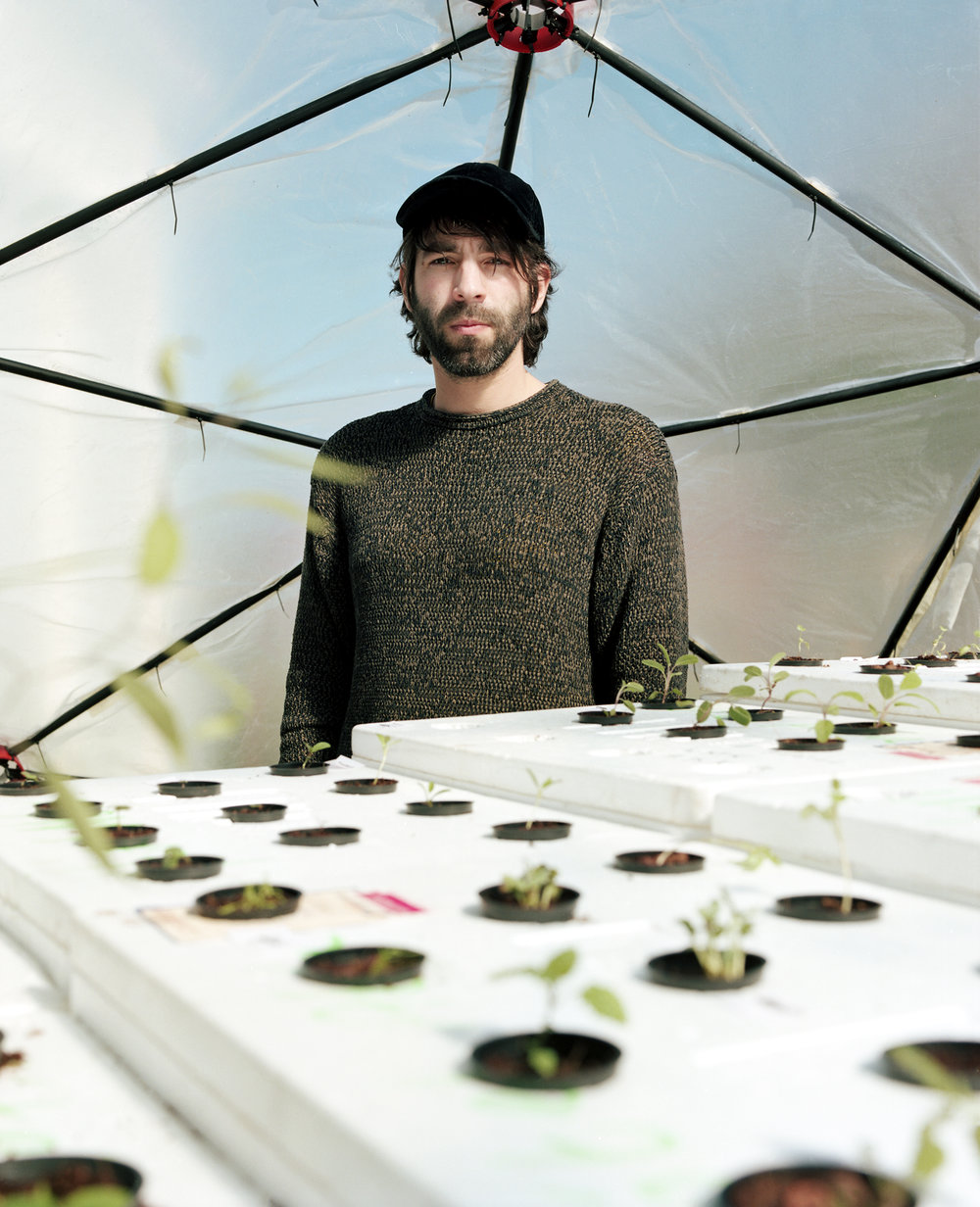 Phillipe in the greenhouse of The Scent Bank. He distills different foraged items to create a portrait of the fjord through fragrance.