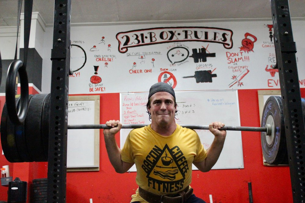 "Nick has been a member of CF231 since its opening 2 yrs ago. If you drop by the gym most days at 6pm you will see Nick working on his olympic lifts during the open gym. If you stay for the 7pm you will see Nick taking on the daily WOD. We asked Nick some questions regarding his Crossfit experiences. Hometown? West Babylon What is your occupation? Construction Project Manager How long have you been CrossFitting? I have been Crossfitting 2 years, I am a charter member of CF231. What brought you to CF231? I saw it on Facebook and it's convenient location What was your first impression of Crossfit after your first ""real"" wod. How sick it made me feel, yet how much I loved it. What makes CF231 special to you? It's a  tight knit family, supportive environment and it has a great deal of open gym time Favorite movement? Deadlift Least favorite movement? Muscle up, although I keep working on them  What movements would make up your favorite WOD? ""Diane is my favorite workout (Deadlifts/HSPU) What motivates you to keep coming back each day? I love pushing myself and I'm hoping to get into some powerlifting competitions soon What has been the most challenging part of your Crossfit journey? Diet….. I love Italian food Short term goals? Improve my powerlifting and trim some weight Long term goals? Change my ratio between muscle and body fat What/Who motivates or inspires you? I see old pictures of myself at my sisters wedding. Didn't like that double chin Favorite Quote? ""Liift Heavy Everyday"" Have you made any changes in your diet or workouts that have been the most successful? I have cut out refined carbs and got rid of sugar. It has made a big dirrerence in how I feel Any advice for someone just starting out? Give it some time, its hard at first but your body does get use to the abuse. Hobbies? Golf, shooting at the range, hiking Favorite Cheat Meal? Villager boneless Buffalo wings and Beer What Superhero would you be ? Captain America….Definitely Favorite workout music? Rock Something no one at the gym knows about you? I'm a big Lord of the Rings fan, I have a LOTR tattoo which no one can see….."