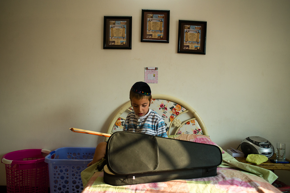 Mashie brings over teachers to the house to help with homeschooling. Zalman is learning violin.