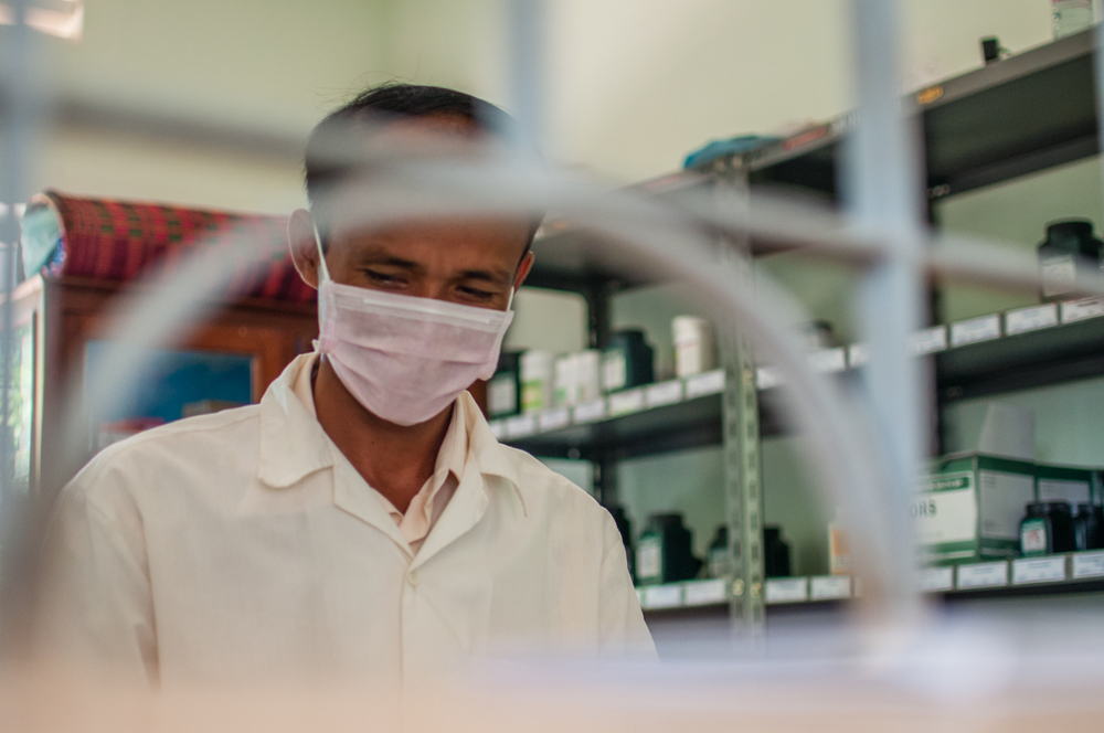 A pharmacists prepares medicine for a TB patient in Pursat, Cambodia on August 16, 2012.