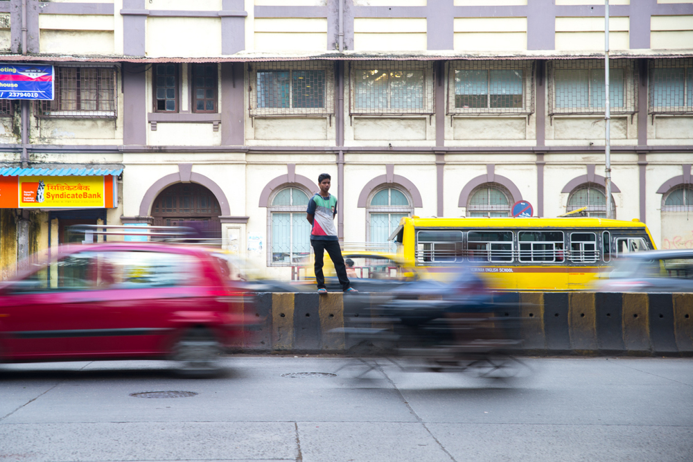 A man attempts to cross a busy street in Mumbai, India, on September 19, 2014.
