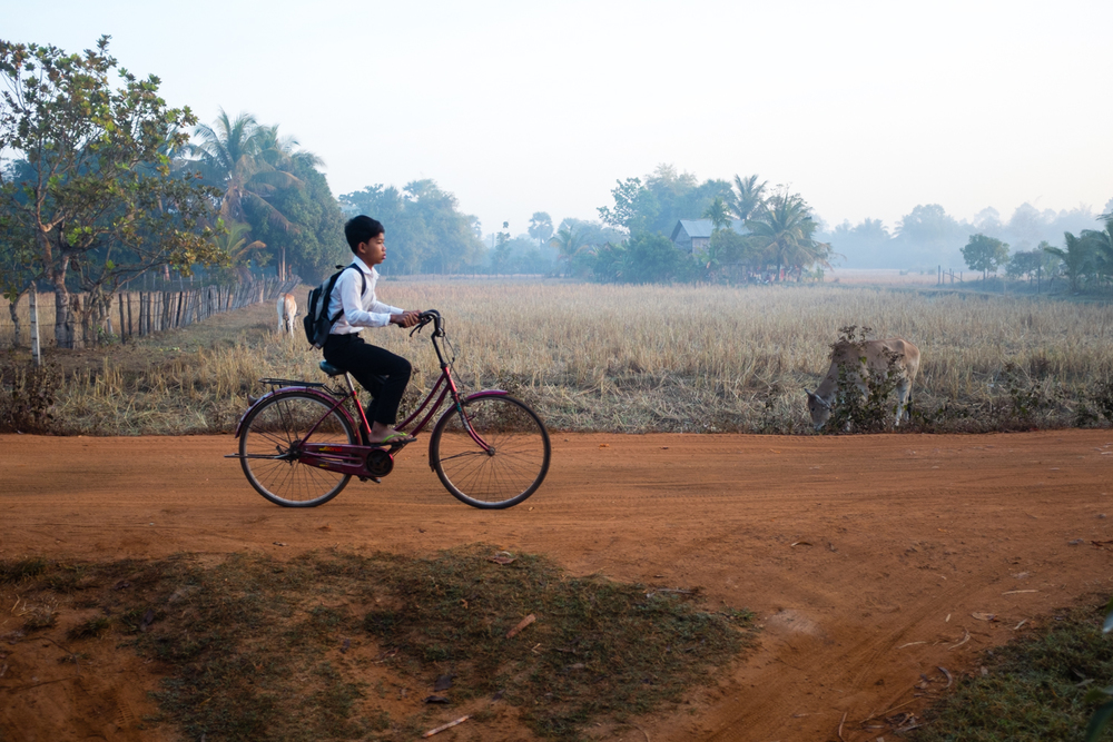 A boy rides to school just outside Siem Reap, Cambodia, on January 21, 2015.