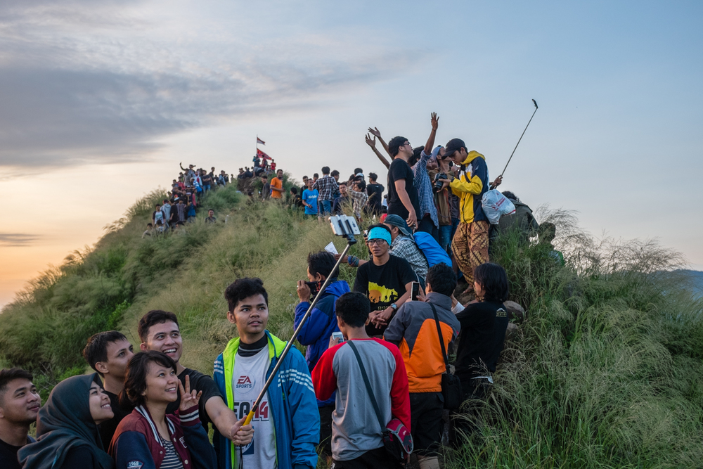 Hikers take photos and selfies after a sunrise hike up Mt. Batu in Jonggol, West Java, Indonesia, on April 12, 2015.