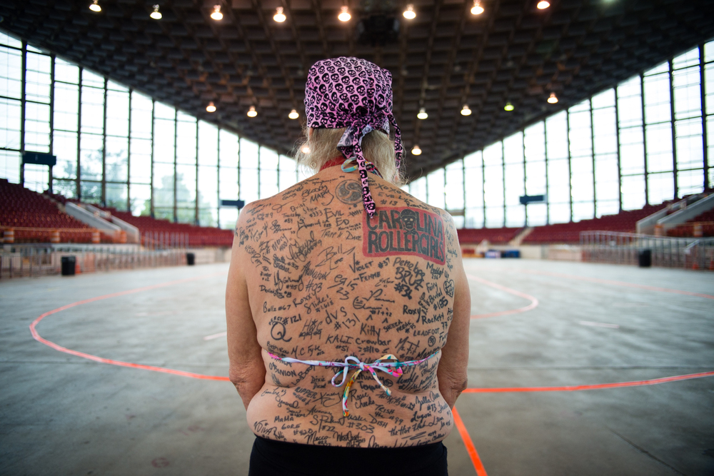 """XX Factor"" shows her tattoos featuring signatures of roller derby players she admires and respects. Raleigh, North Carolina, September 12, 2015."