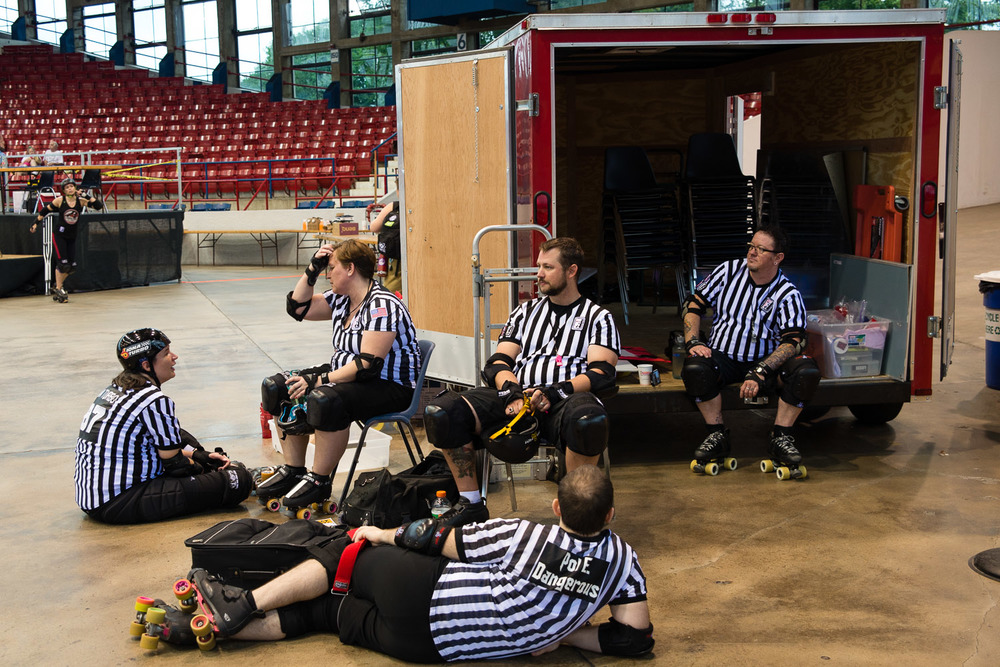 Many referees are needed during a roller derby bout. These five take a rest during halftime. Just like everyone else involved with derby, they are volunteers.