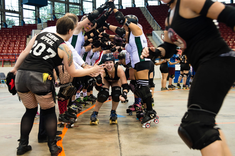 CRG players come through a pyramid made by the opposing team at the end of a game.