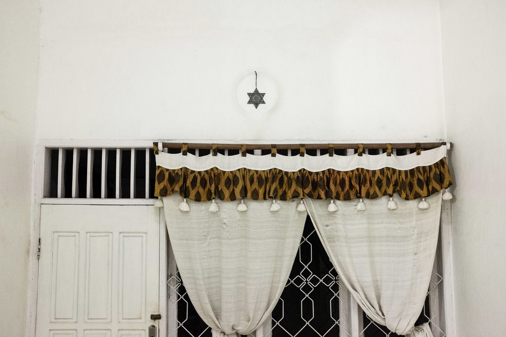 Reginal Tanalisan's house in Manado. He is an integral part of another Jewish group in Manado that is suspected of still having ties to the Church, although he continuously denies this fact and proudly displays Jewish elements and decorations in his house.