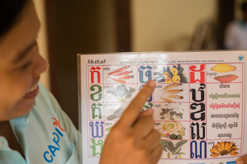 Chea Phearom explains how she uses charts like these to help her patients learn new words and how to say them.