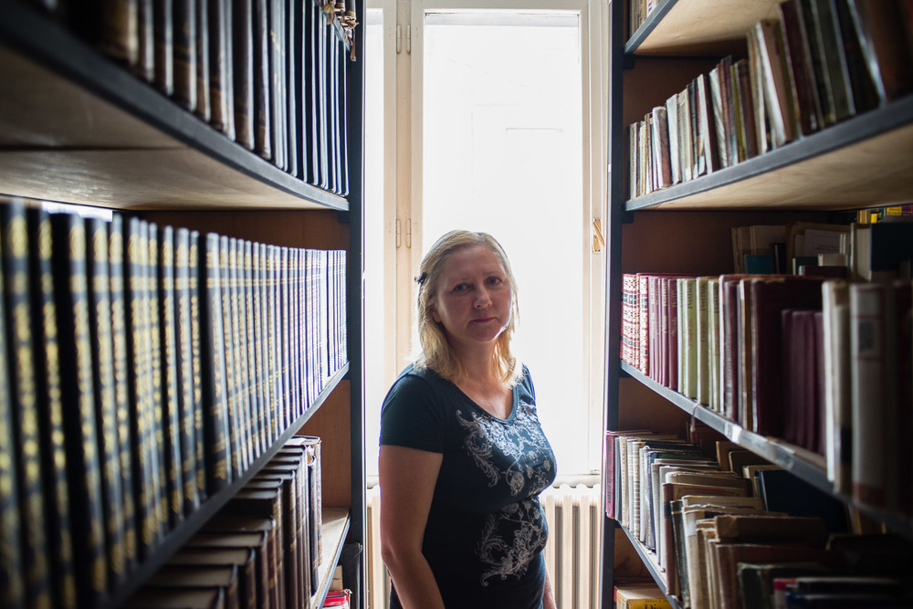 Gordana Girt is the manager of the small but neat library collection housed at the Jewish Center. All books are free to take out by anyone--although few outside the Jewish Community know the library exists.