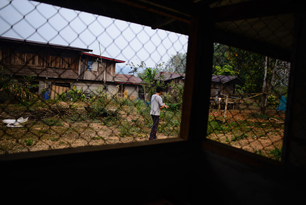 Samai Pakmee, an activist leader in Na Nong Bong, takes a cigarette break outside of his house in the early moring. During the lead up to the court case, his home became a center for many activits, including a training on media and video production geared towards the youth in the village.