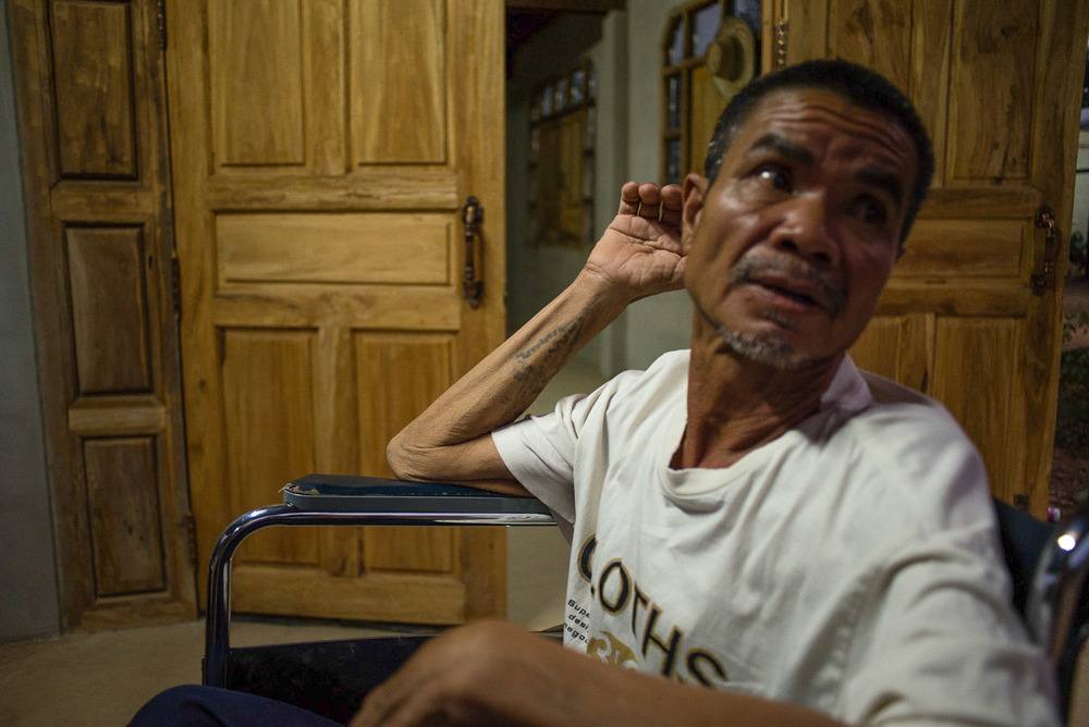 Suwat Jutnai, 61, continued to work in his rice paddies and eat his crops after it was revealed they are both contaminated with heavy metals, allegedly by chemical runoff from the goldmine. He has suffered severe nerve damage from cyanide poisoning and has lost full control of his motor skills due to progressive muscle atrophy.