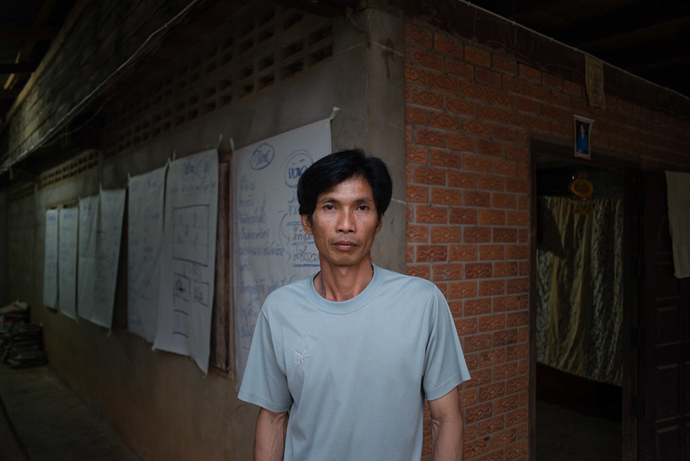 Samai Pakmee is a prominent activist in Na Nong Bong. He stands in front of his house, which, in the leadup to the court cases, has provided a meeting space and training center for other activists.