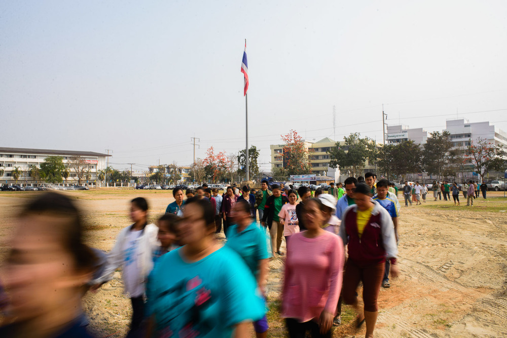Villagers from Na Nong Bong march towards the Loei courthouse. They have come en masse to support the village's defense in the criminal case levied against them by Tungkum Ltd.