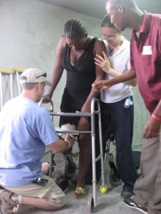 Chase fitting a new prosthesis on one of the first Haitian patients at Prosthetics of Hope