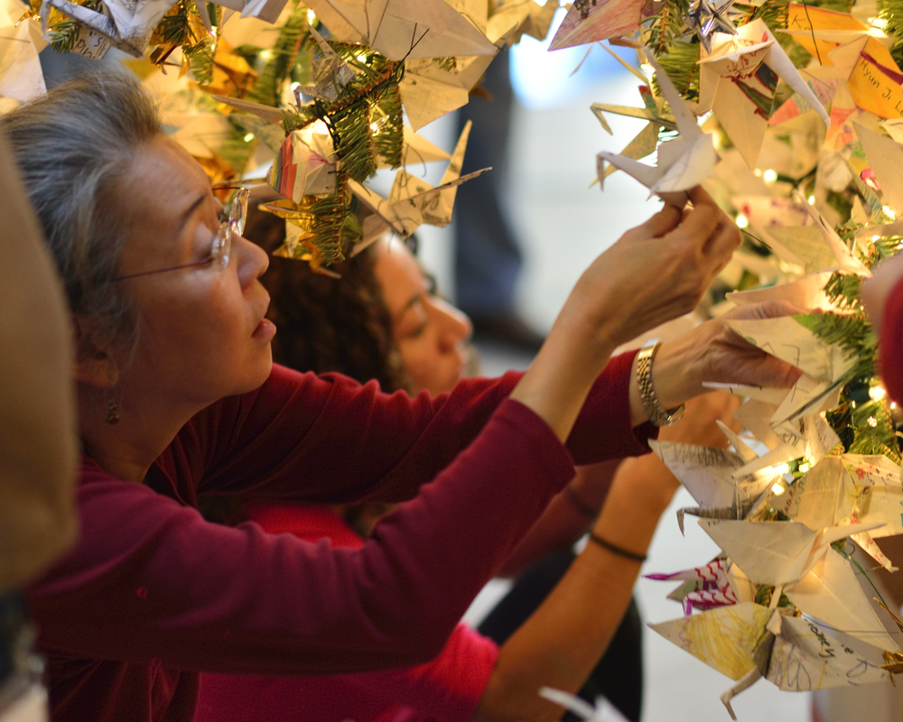 RWF Board member Karen Kai decorates the 2013 RWF World Tree of Hope.