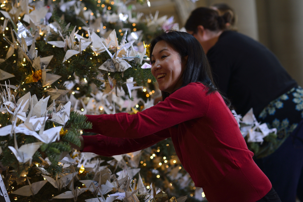 It takes a village to create the tree - over 300 people fold the origami and decorate the tree each year.