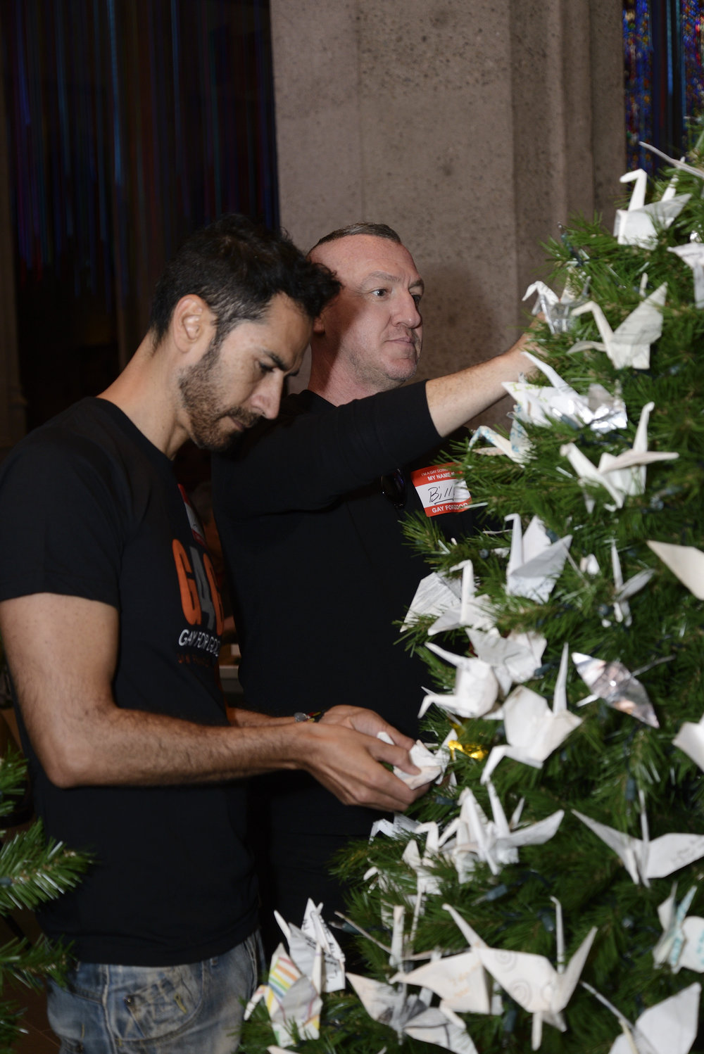 Volunteers decorating the World Tree of Hope at Grace Cathedral.