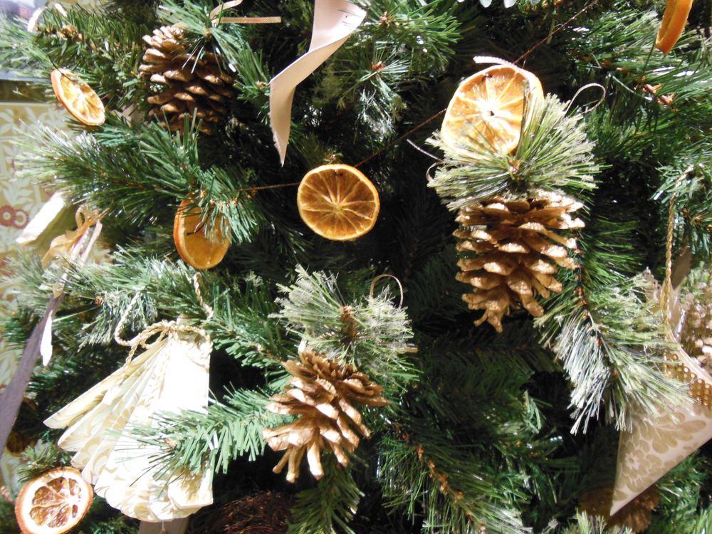 Dried orange slices strung as a garland through a Christmas tree.