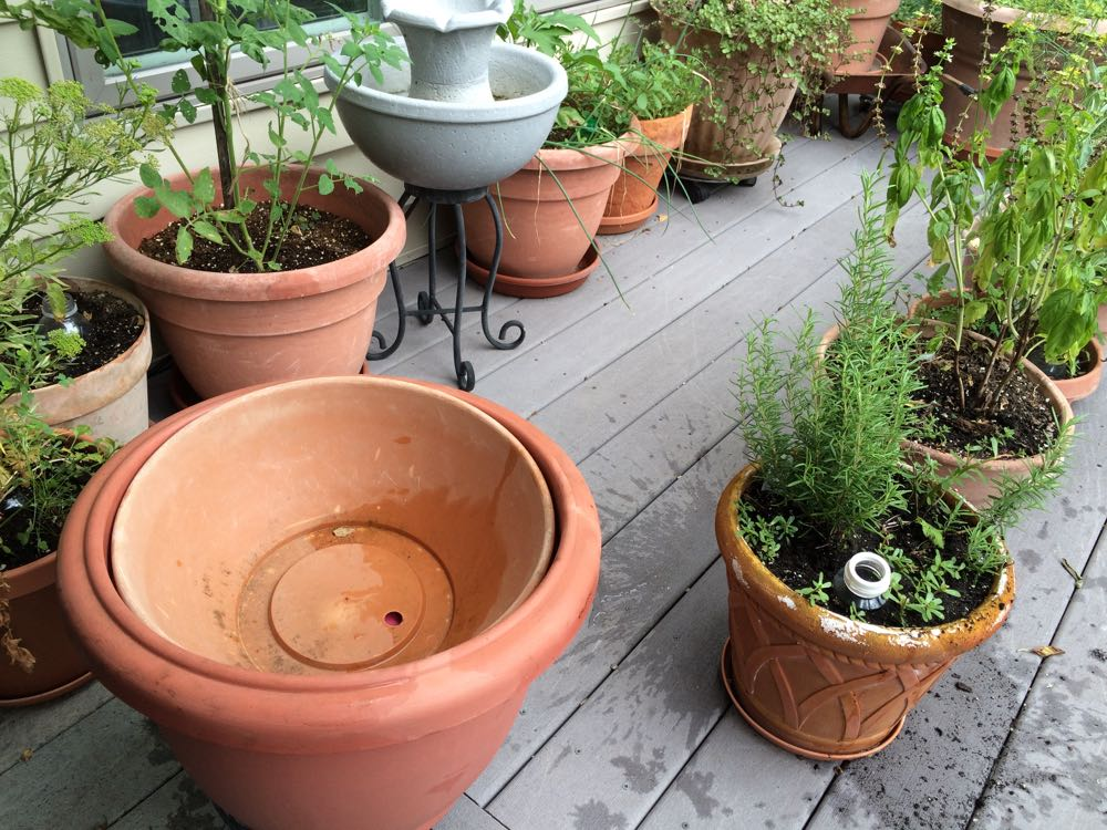 I use a shallow round planter with a hole as a lid to prevent wildlife and bees from falling in.
