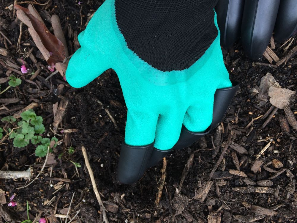 Garden gloves with claws worked quite well in loose soil and compost.