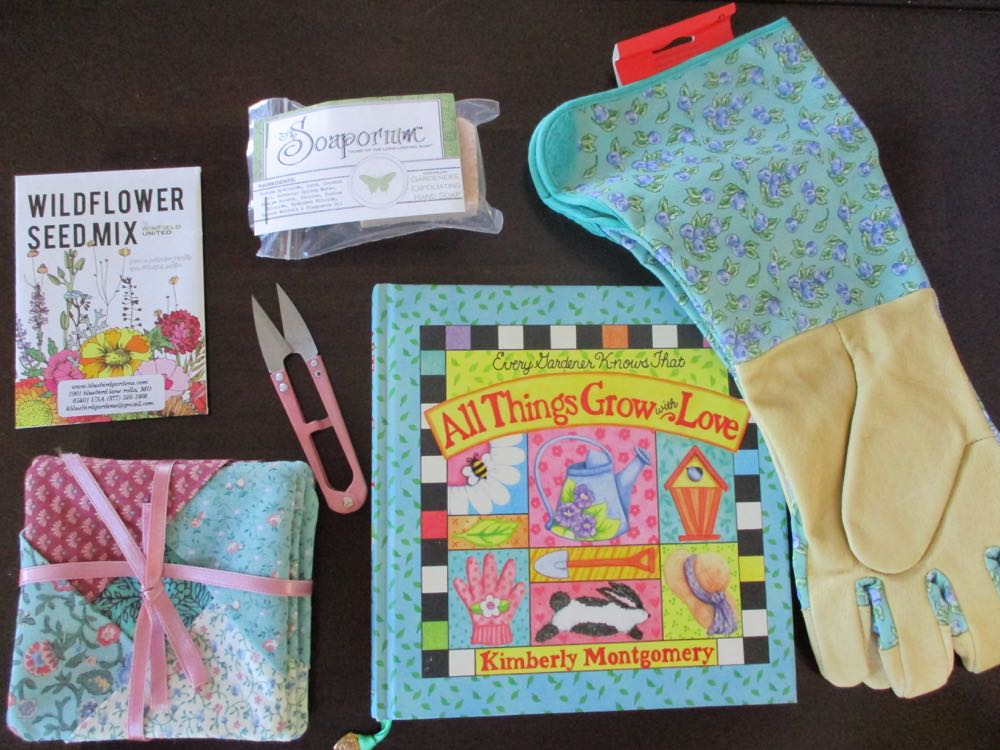 Sneak peek at what's inside this custom gardener gift kit, the book has a charming book mark.