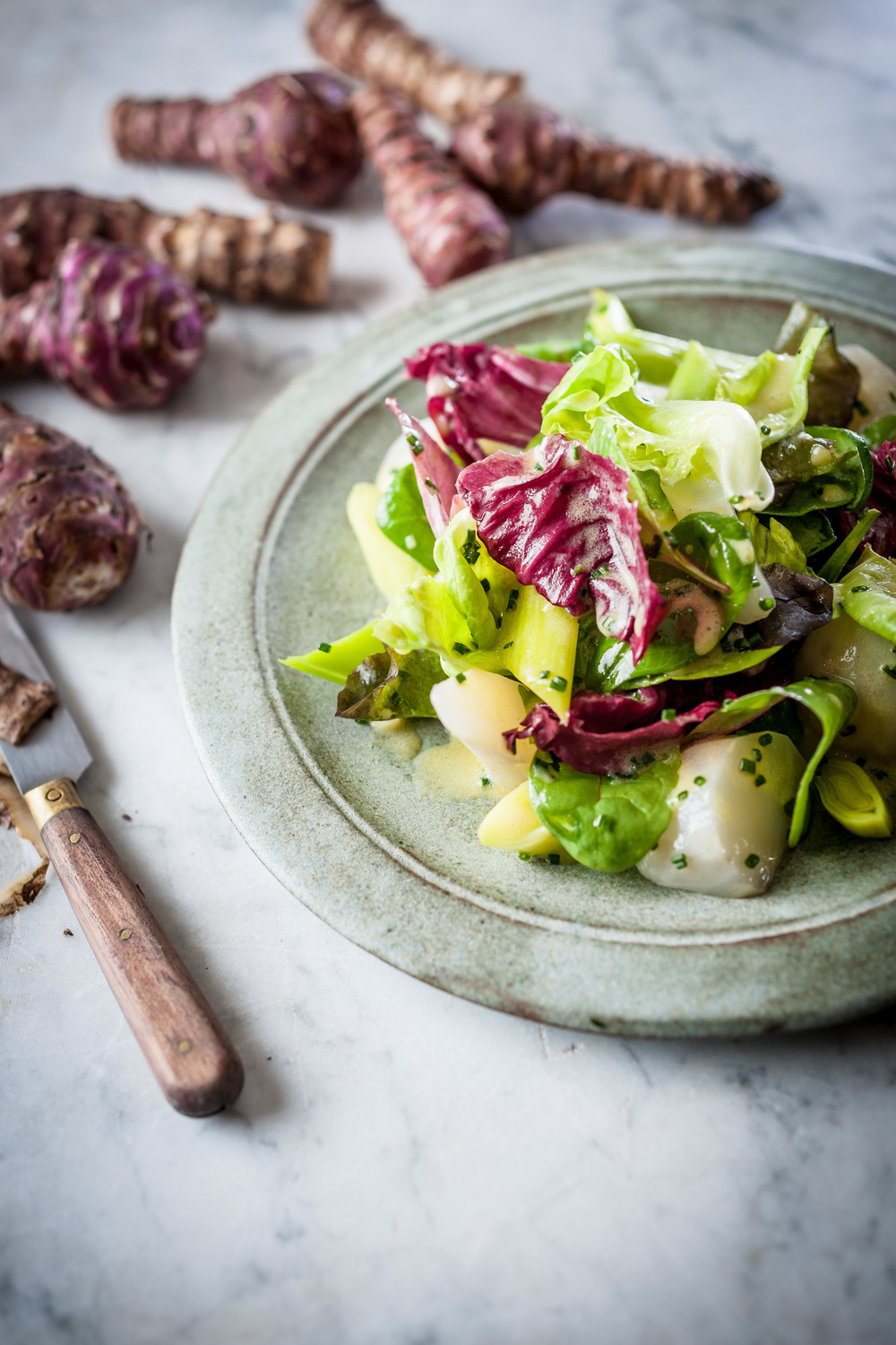 WARM SALAD OF LEEKS, JERUSALEM ARTICHOKES AND WINTER LEAVES  Photograph © David Griffin 2014.