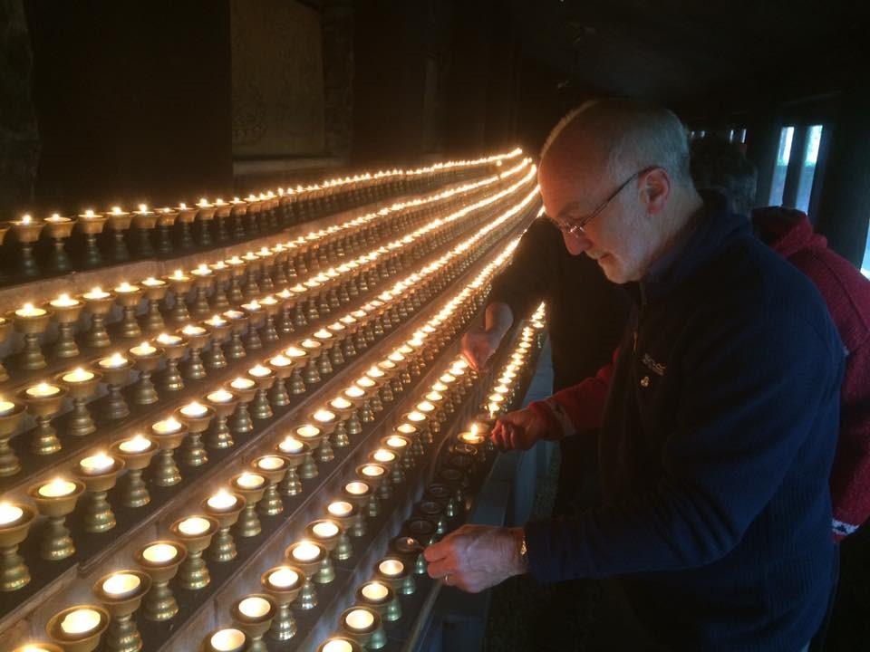 Frank lighting candles samye ling.jpg