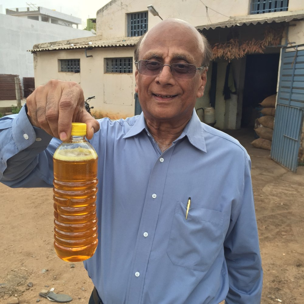 Dr Prasad with fresh pressed pongamia oil