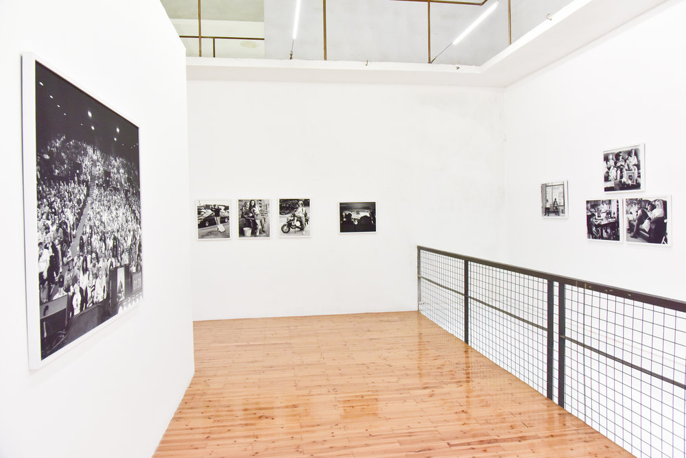 Installation photographs of Removed series by Eric Pickersgill at Lianzhou Foto Festival in Lianzhou, China 2016. Removed is a series of large format black and white photographs that are of individuals performing as if they are using thier devices although thier phones and tablets have been removed from thier hands moments prior to the exposure.