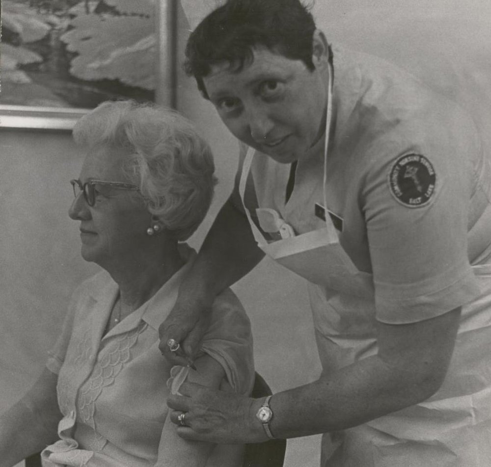 Nurse Giving Elderly Woman a Shot.jpg