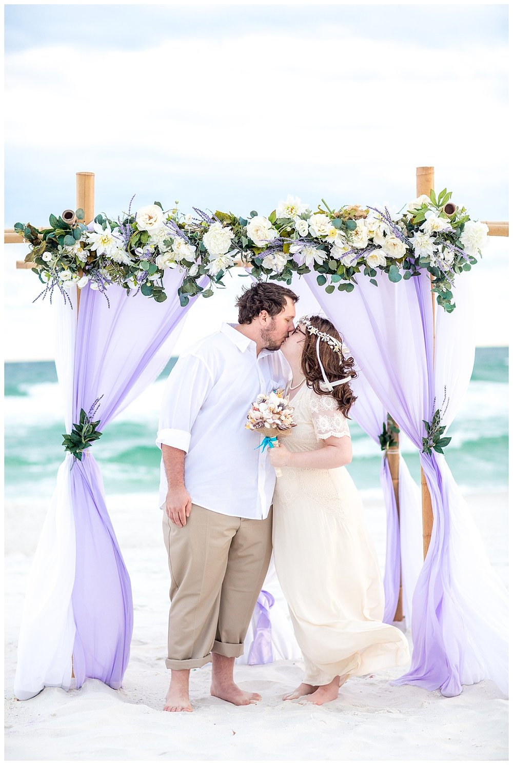 7 Wedding Couple under the wedding arch .jpg