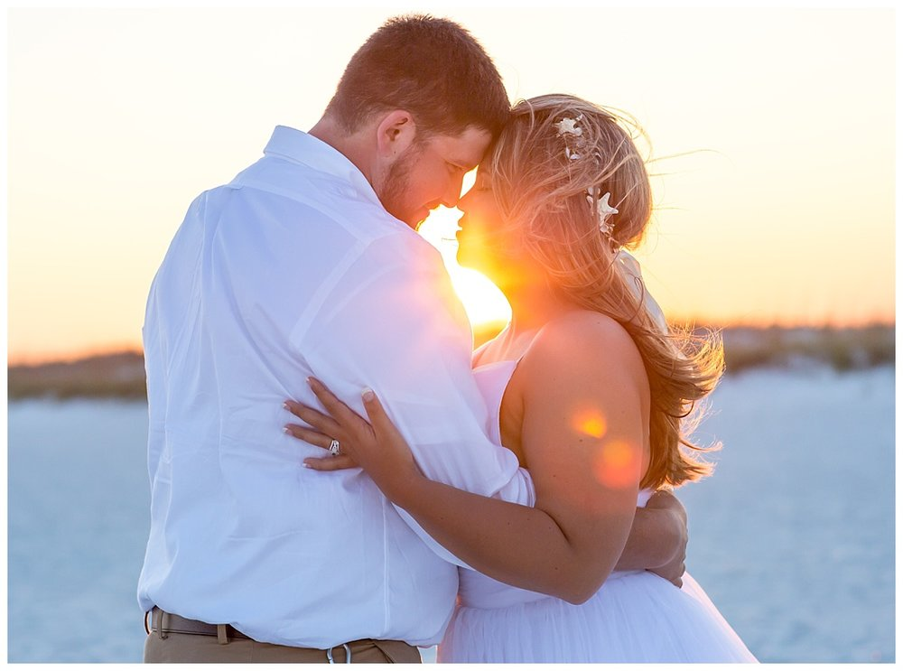 Bridal Pictures, Groom and Bride and the sun between of them