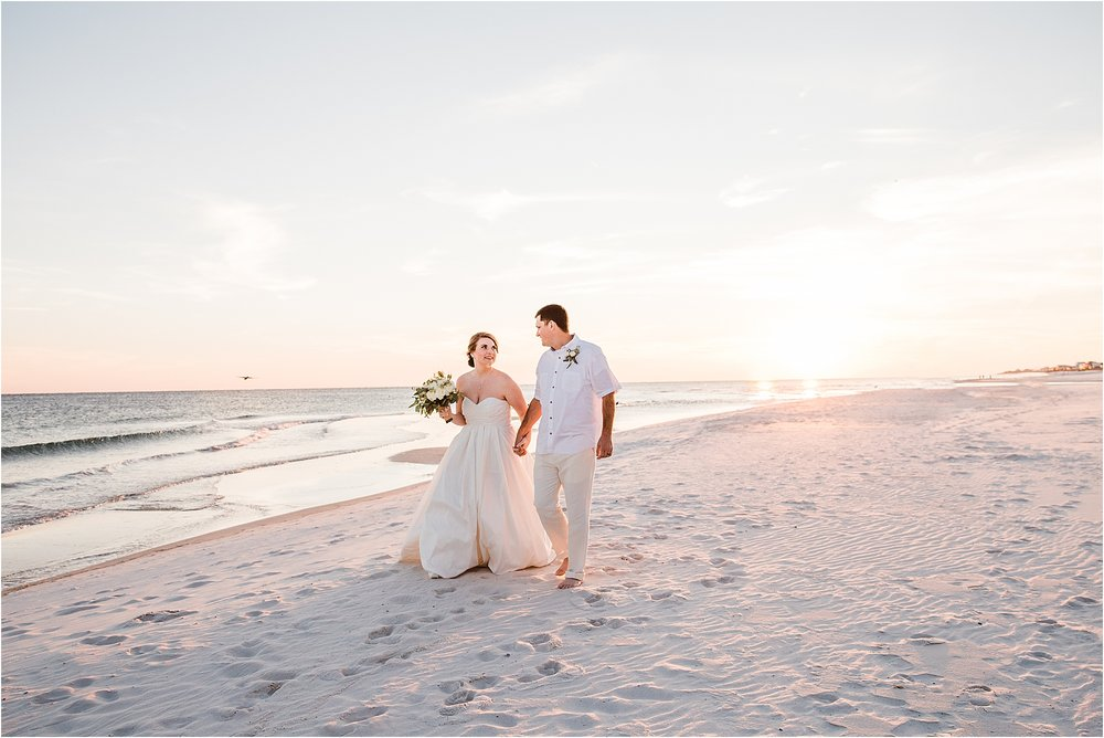 Walking on the beach after the wedding