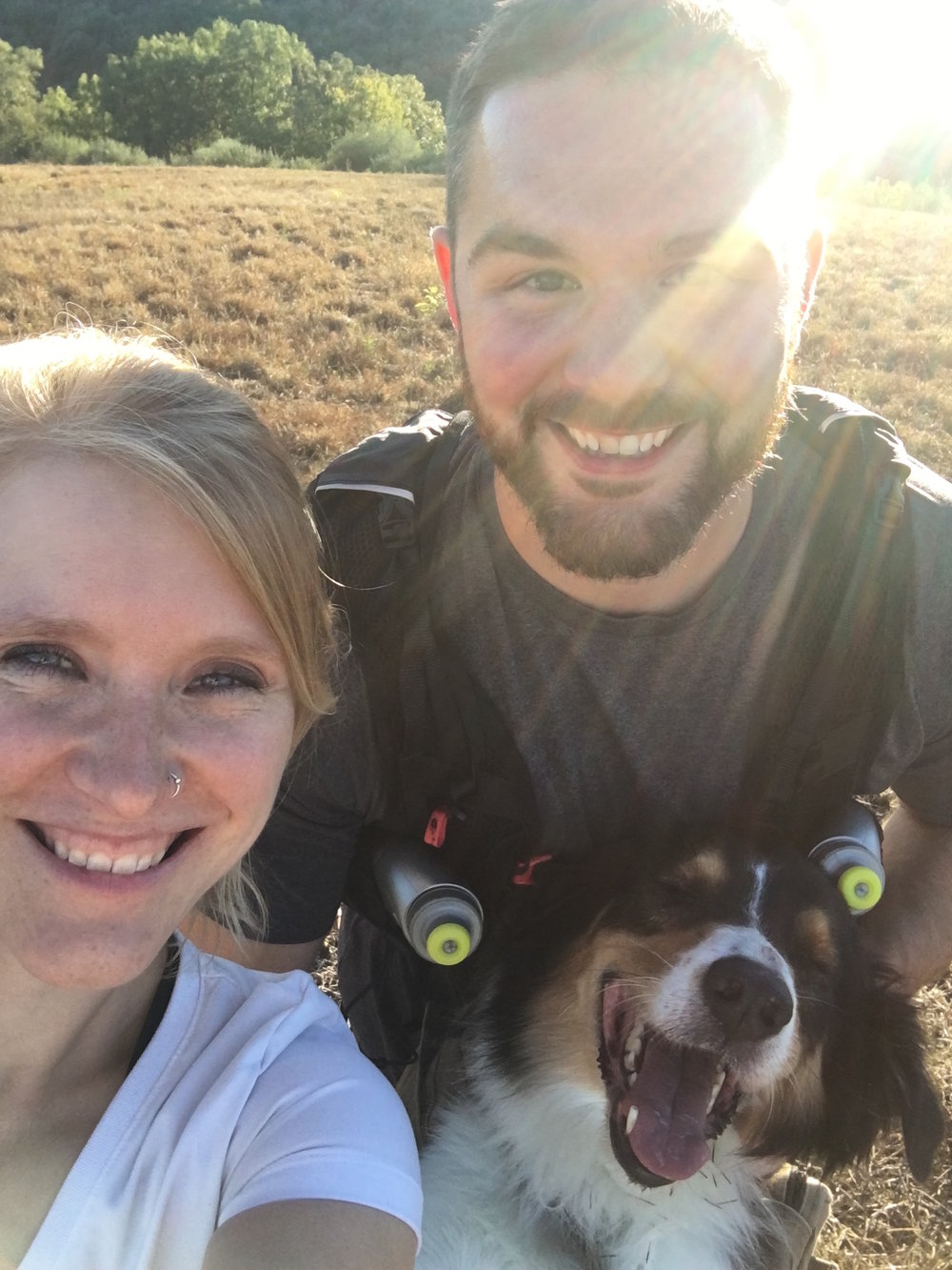 Pictured: Serina hiking with her husband and their dog