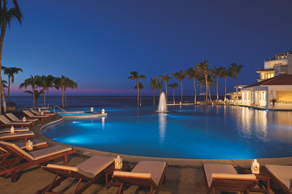 A nighttime view of the infinity pool facing the Sea of Cortez