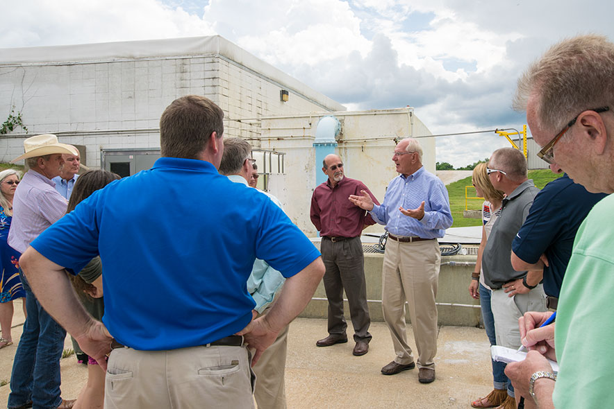 Mark Simmons, Chairman of Simmons Foods, participates in a wastewater tour. Over 600 attendees have toured the facility in the last 15 years.