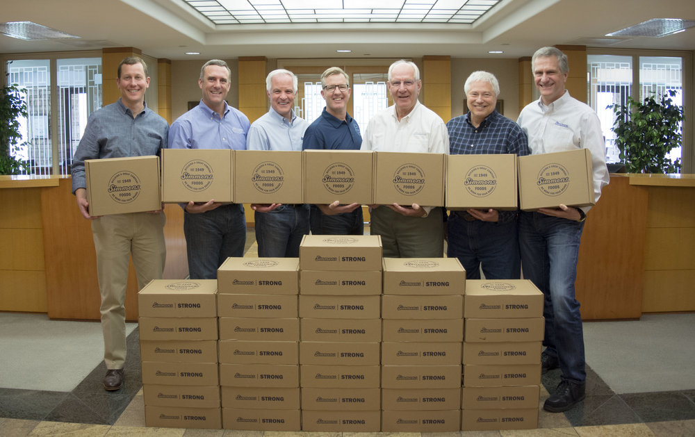 Simmons Foods Execute leaders distributed Simmons Strong boxes to team members