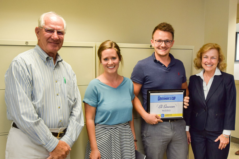 Pictured left to right; Mark Simmons, Simmons Foods Chairman, Kristina Arge Simonsen, Eli Simonsen, Simmons Prepared Foods Cost Accountant, Dr. Delia Haak, JBU Adjunct Instructor