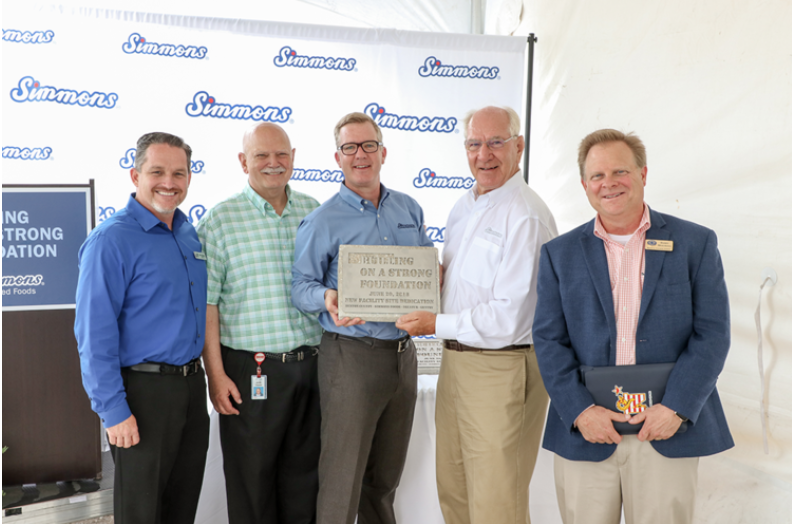 Pictured from left to right: Kevin Johnston, Mayor of Gentry; Bob Tharp, Mayor of Decatur; Todd Simmons, CEO and Vice Chairman, Simmons Foods; Mark Simmons, Chairman, Simmons Foods; and Judge Barry Moehring, Benton County.