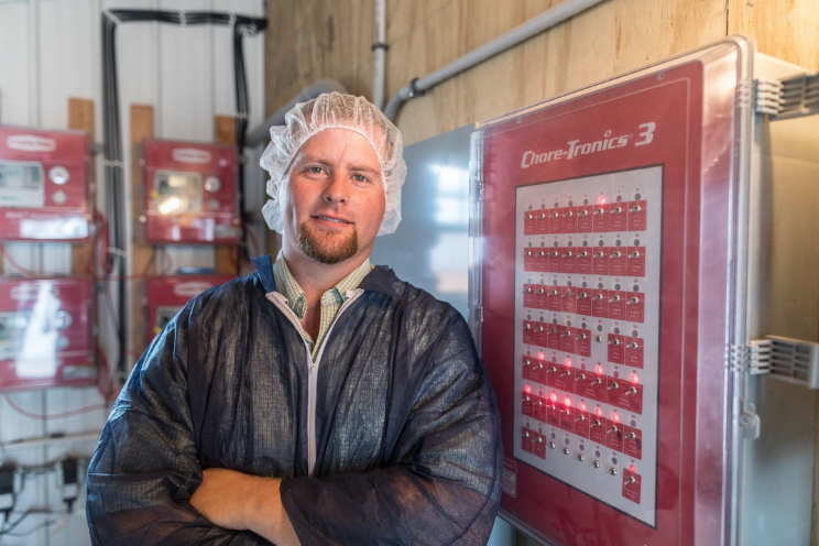 A Simmons Foods research farm manager provides an overview of a chicken house control room.