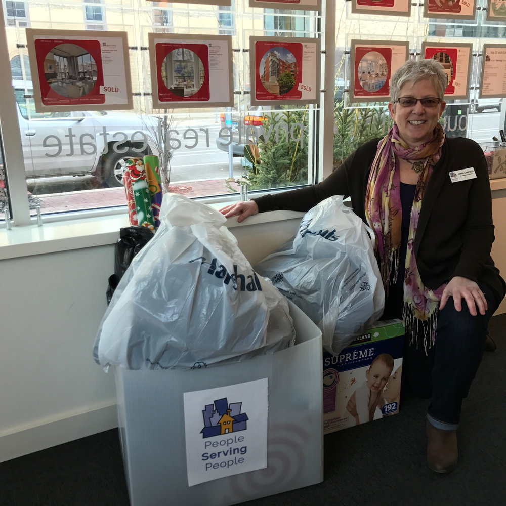 Gwen Campbell, Development Director for People Serving People, stopped by the office to pick up Holiday donations last year. Thank you for your contributions!