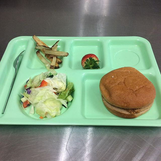 Homemade sloppy joes, potato sticks, salad, and a strawberry for dessert. #edibleschoollunch @annacontrerasrdm