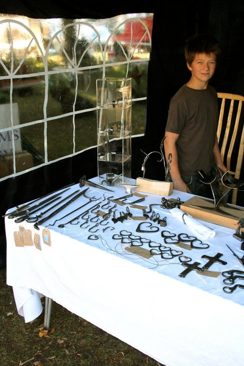 13 Year old me selling items at my first craft faire. I spent the entire summer holidays hammering away preparing for this, I sold £500 of my work at this event and was totally flabbergasted! I made every penny of that count, investing in more tools for the shop! Some you see in use today in my YouTube channel.